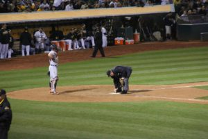 an umpire brushing off the plate